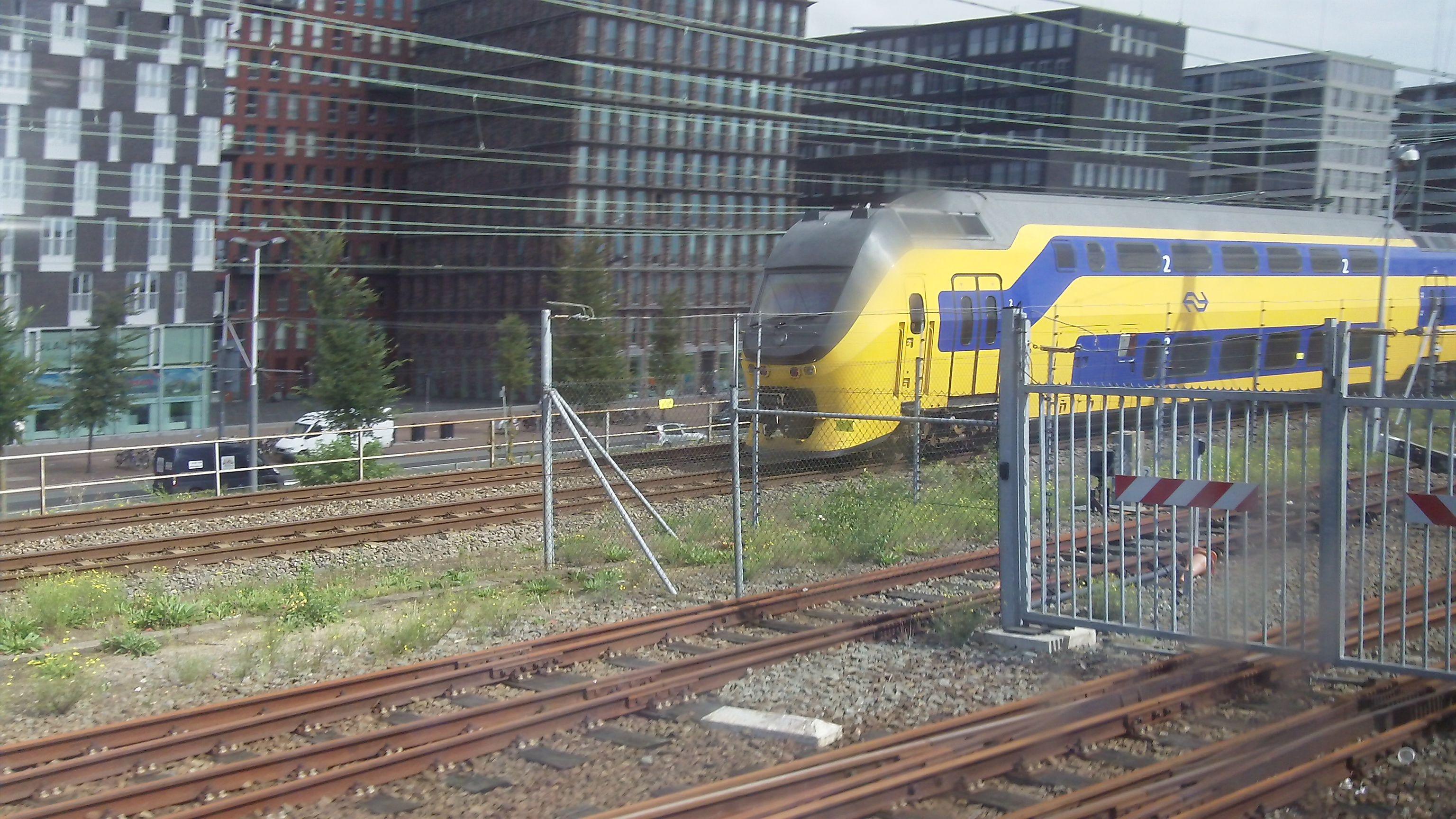 Click to view larger image of passing a commuter train while on board an inter-city express train. Amsterdam, Netherlands. September 2014
