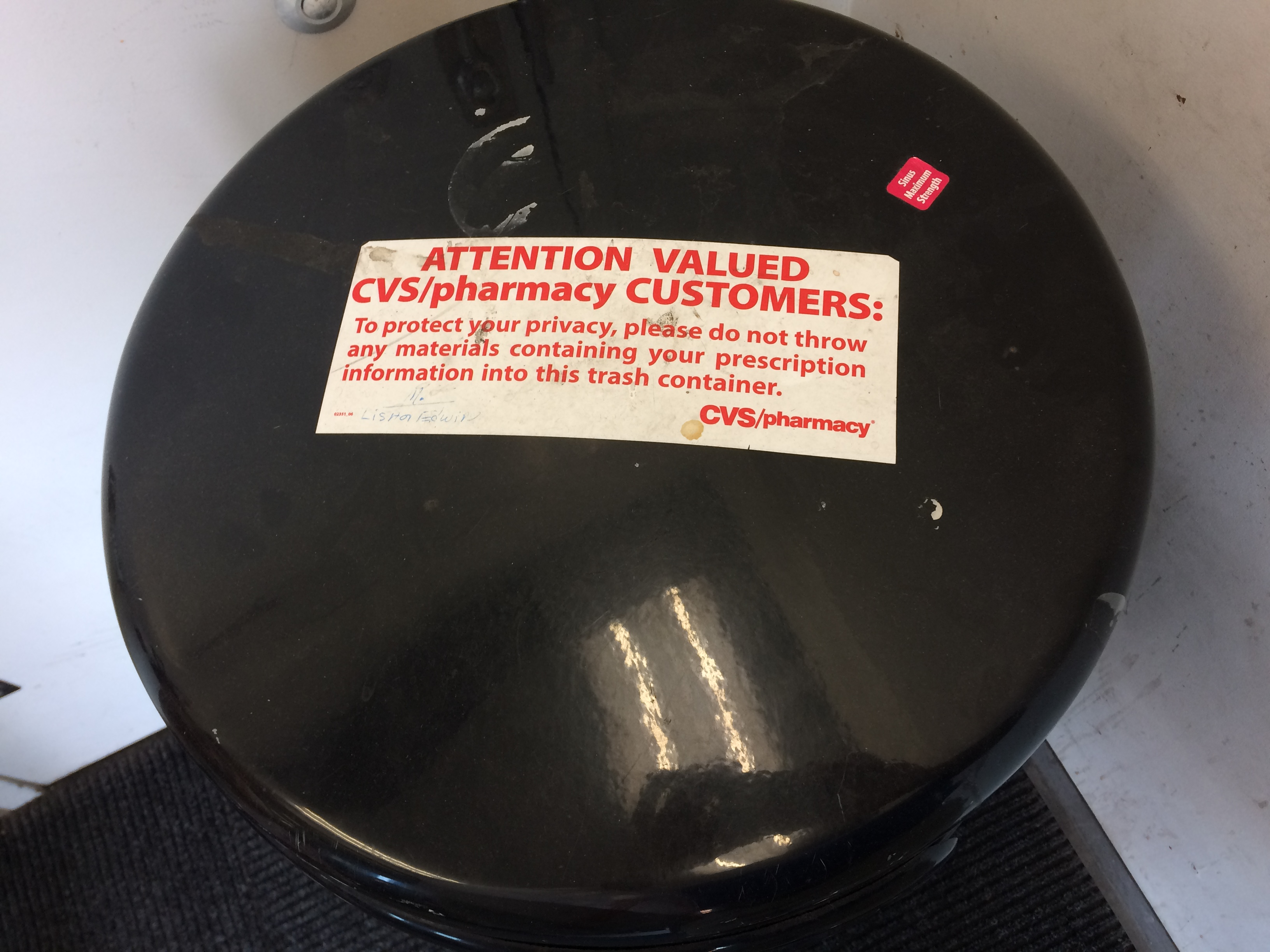 Image of trashcan in CVS Drugstore in Brookline, Massachusetts. Click to view larger version