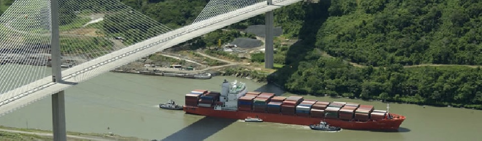 Aerial view of a ship in the Panama Canal. Click to view larger version